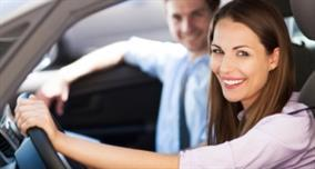 Image of happy couple driving after car service