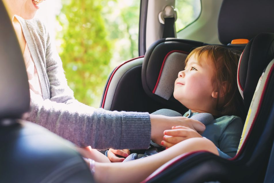 child in car seat in properly maintained vehicle