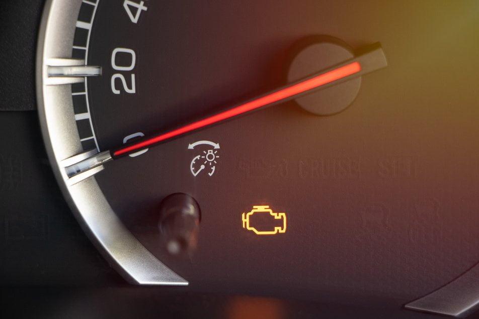 engine warning light on dashboard of vehicle