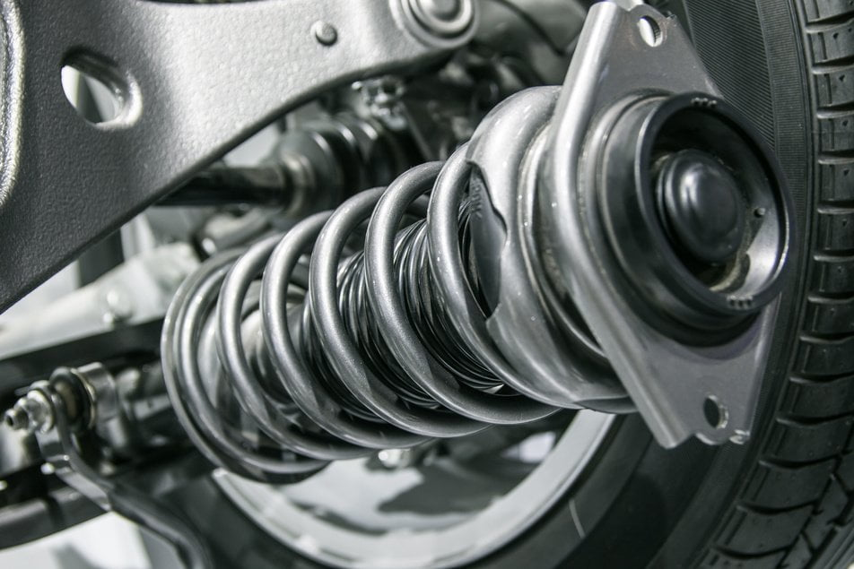 shocks in vehicle suspension assembly