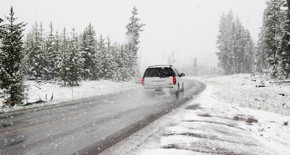 vehicle driving on salt covered roads in winter