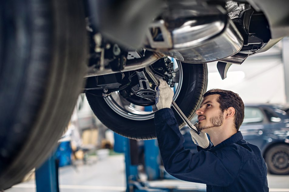 ASE certified technician working on vehicle