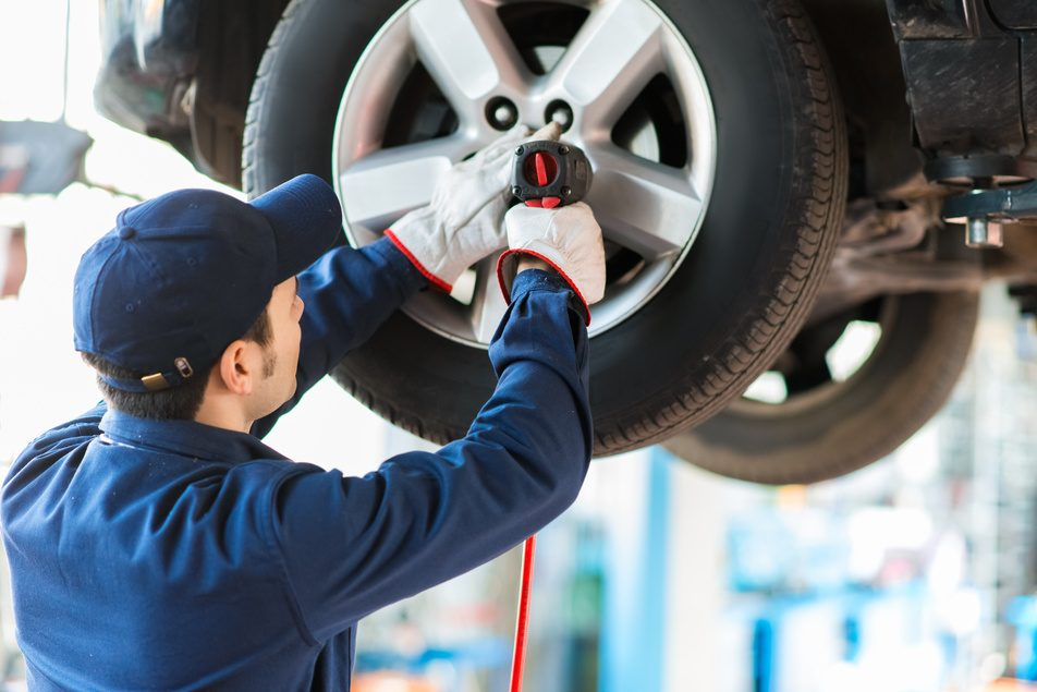 ASE certified mechanic at custom complete automotive servicing vehicle
