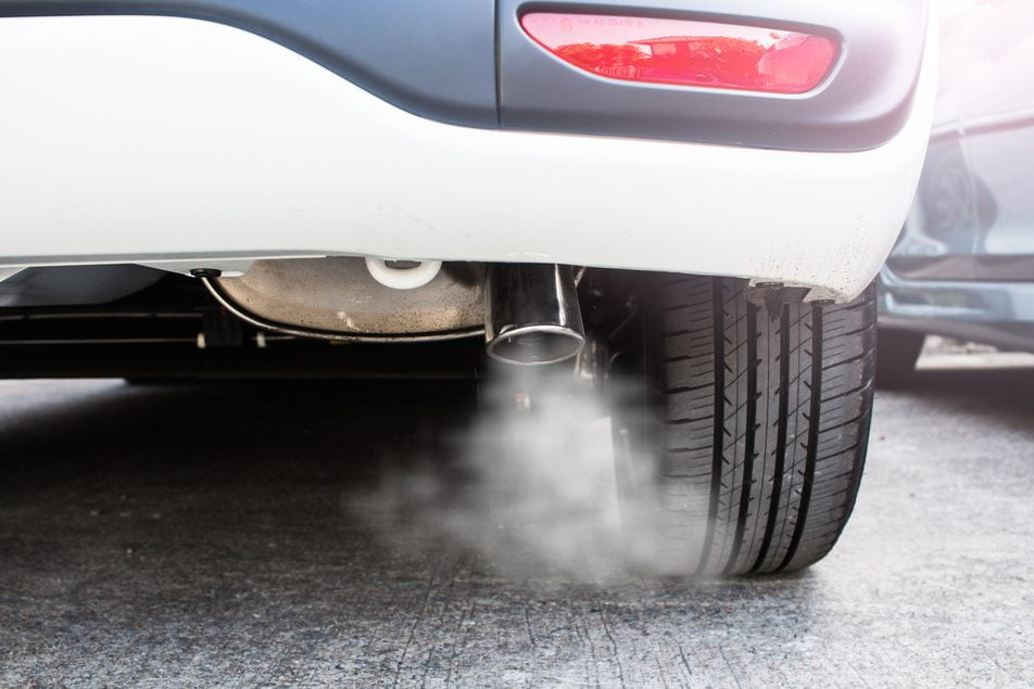 white exhaust smoke flowing from vehicle
